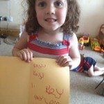 Learning to write her name unaided