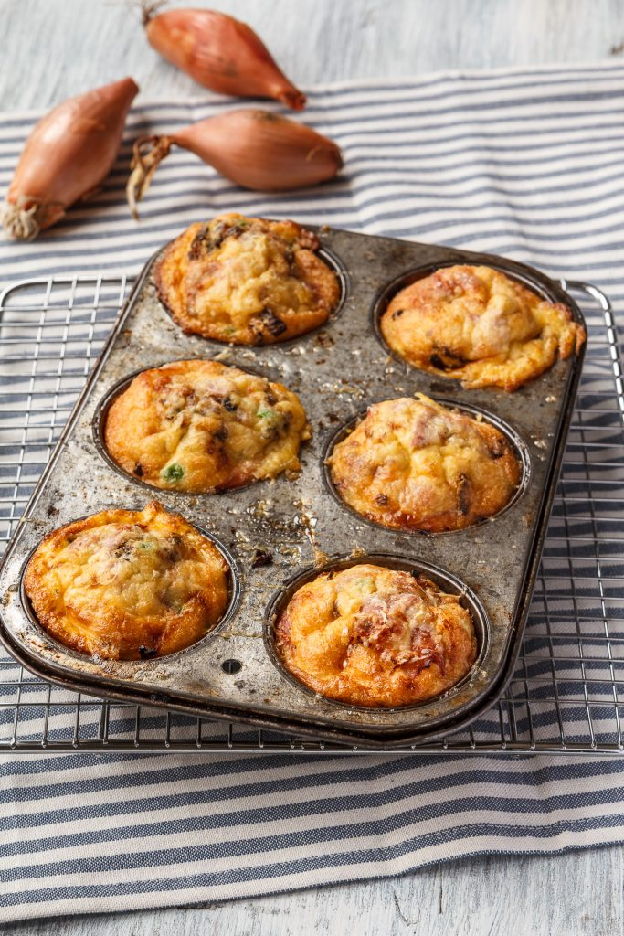 Muffin tin frittatas with shallots, roast new potatoes, turkey and peas